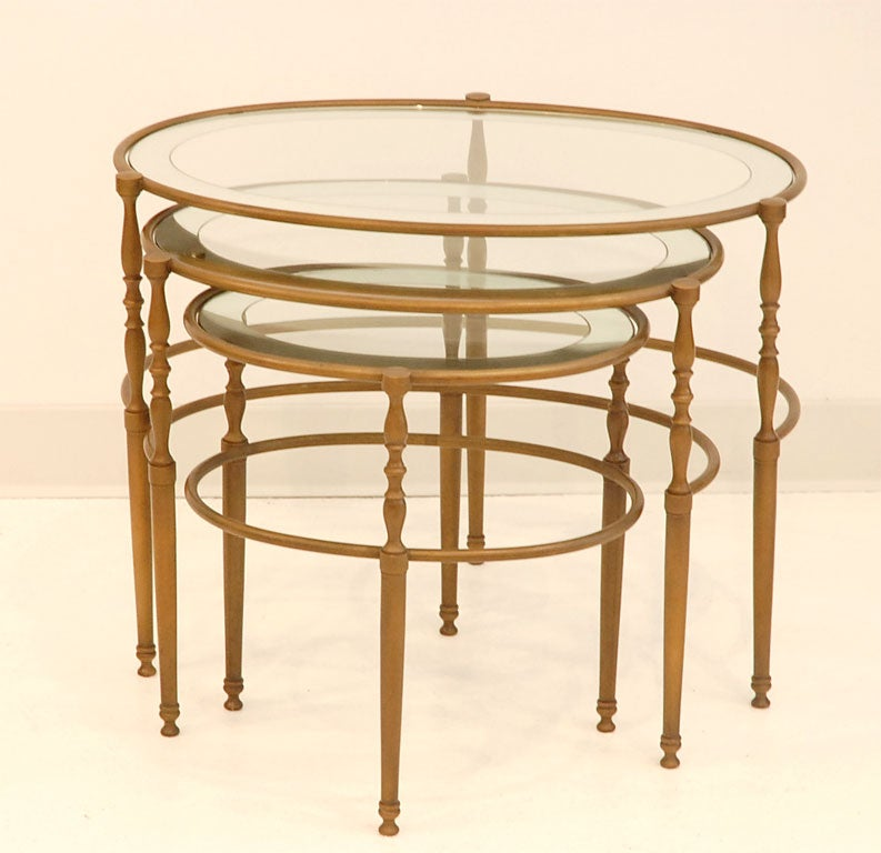 Patinated bronze oval nesting tables with mirrored glass for Glass top nesting tables