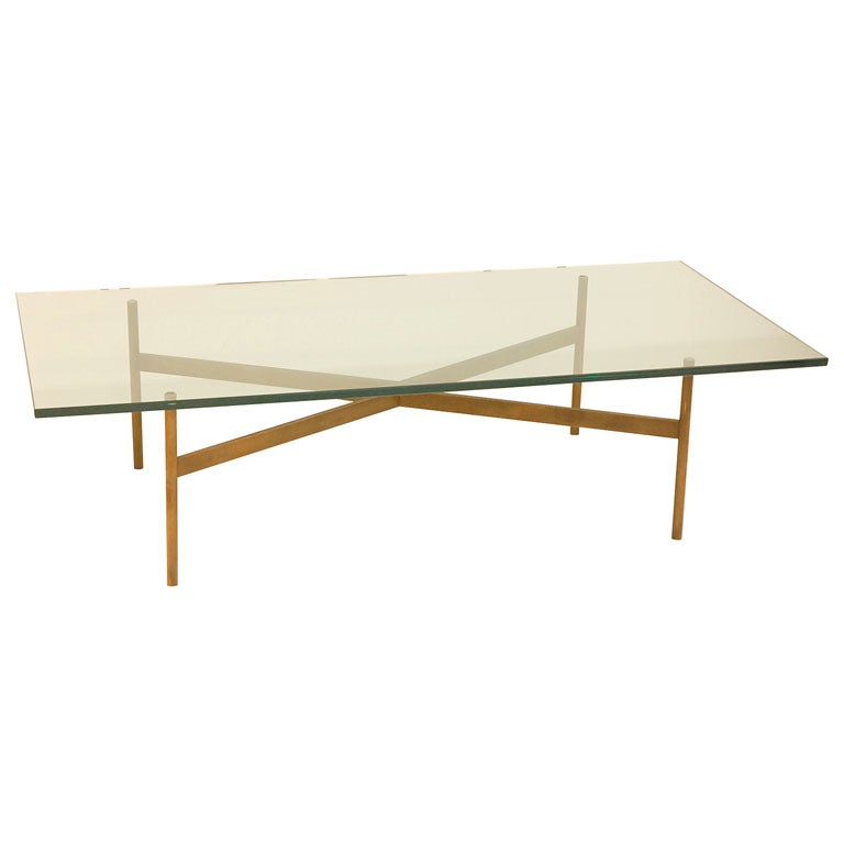 """Elegant Glass And Metal Coffee Table: An Elegant Bronze """"X"""" Base Cocktail Table With Glass Top"""