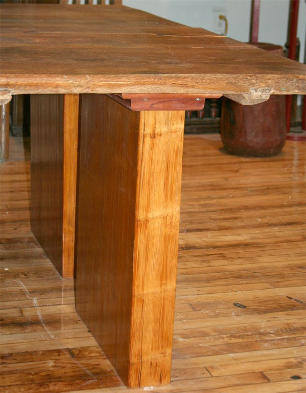 matched pair of dining tables made from antique doors at