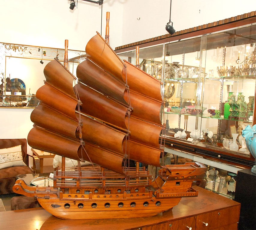 Of traditional Chinese design with rectangular sails spread by battens, a high stern and flat underside.