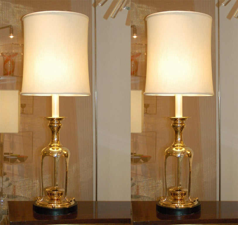 Large pair of lamps in the style of James Mont.  ***Contact/Shipping Information: AOL (American Online) users may experience difficulties sending emails to us or receiving emails from us. If you have made an inquiry to us and have not received a