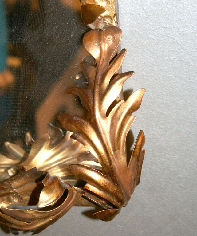 Gilded iron acanthus leaves attached to gilded iron frame.