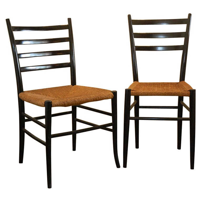 4 Gio Ponti Chairs With Black Wood With Cane Seats 1