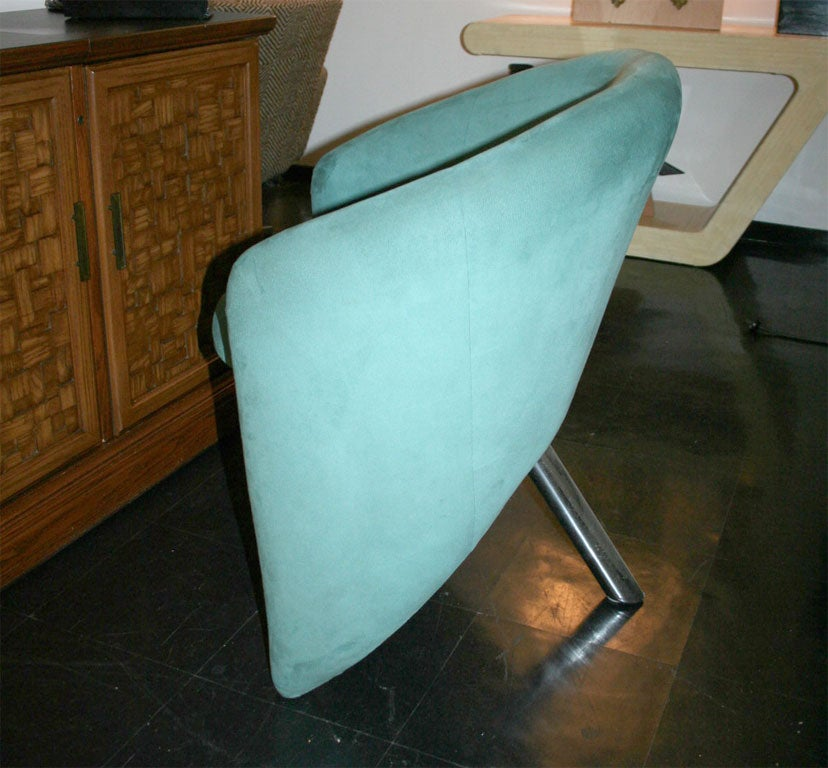 a pair of unique shaped lounge chairs at 1stdibs