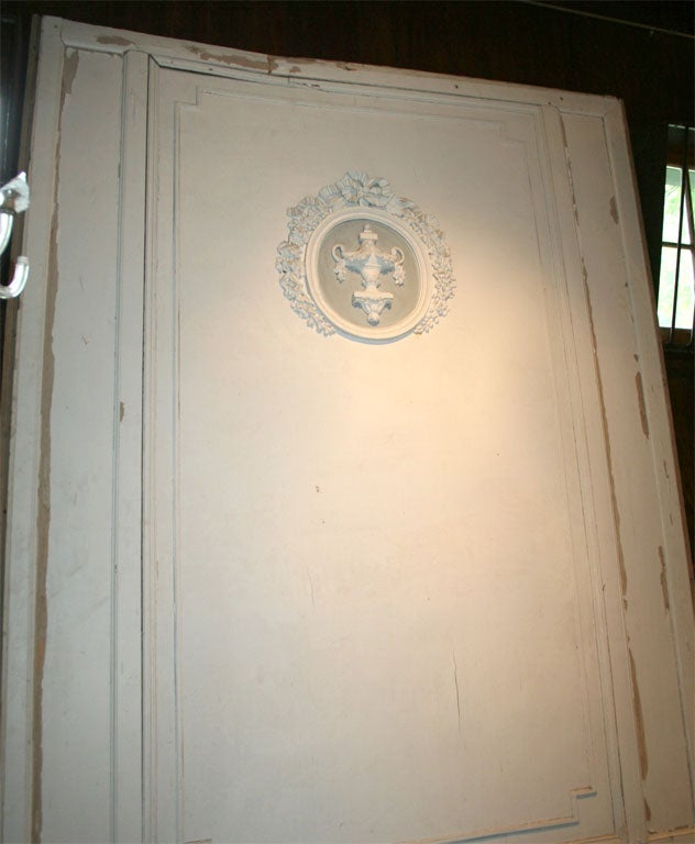 Signed Maison Jansen boiserie panel with oval medallion decoration.