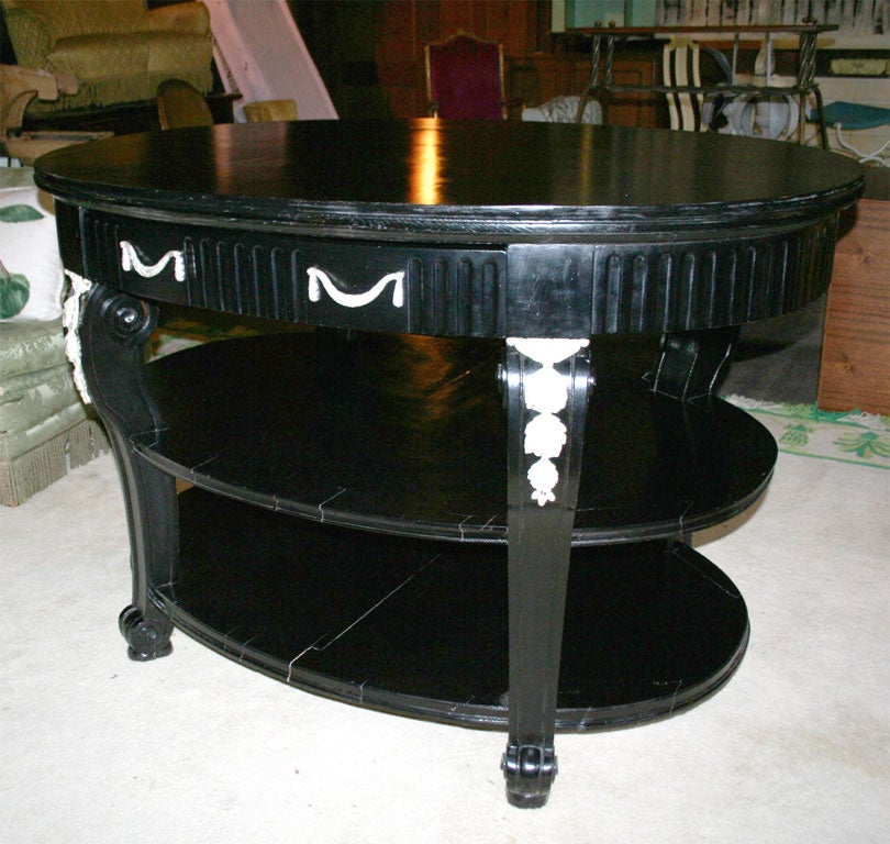 Store display black painted wood three-tiered oval table with two large drawers. Original ormolu has been replated in a silver tone.