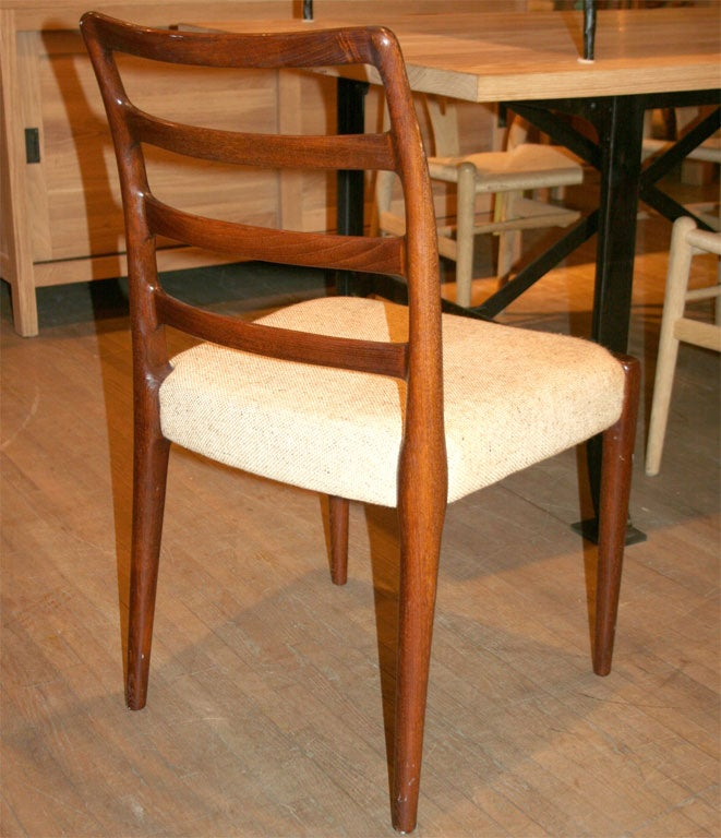 this set of six dark stained teak ladder back dining chairs is no