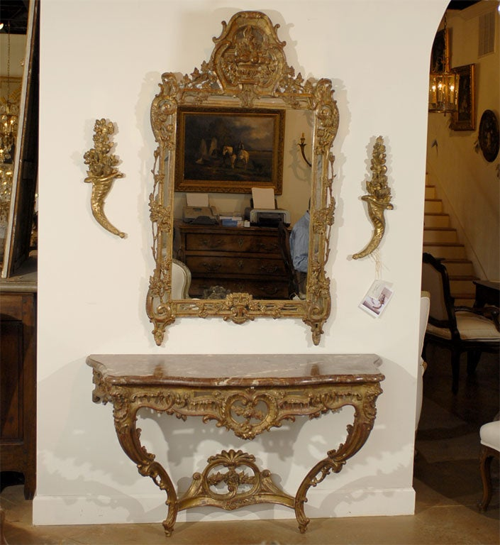 Beautiful ornate gilded wood mirror- French- Late 18th or Early 19th Century. Please Note This Item is an Antique and is One of a Kind.