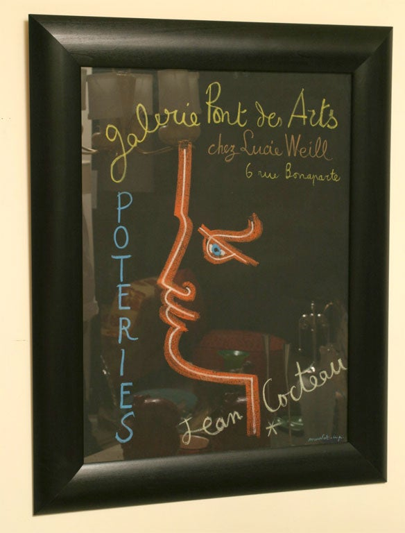 This original and authentic Mid-Century Modern French stone lithograph designed by Jean Cocteau from the 1950s is for a ceramic exhibition of his pieces at Galerie Pont de Arts. It is professionally archivally lined backed and custom framed in a
