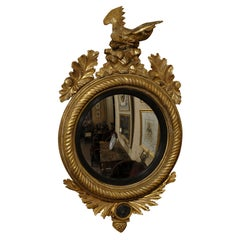 English Regency Black-Painted and Gilt Convex Mirror, c. 1820