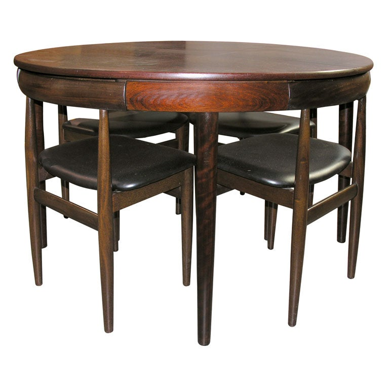 Nesting Dining Tables ~ Rosewood dining table with nested chairs by hans
