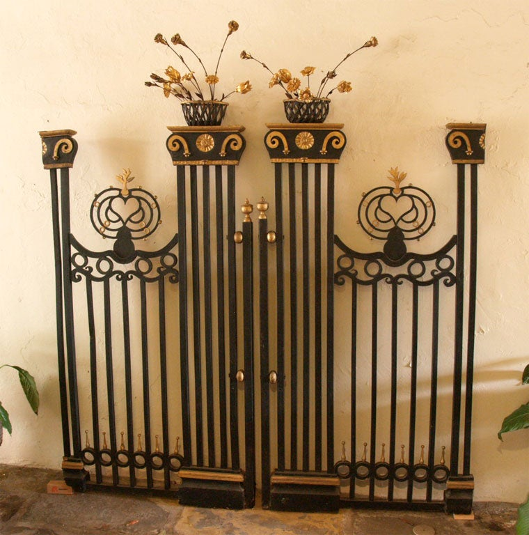 The delicate decorative grills are carved wood with gilded finials and other details. The dimensional baskets are filled with carved and gilded flowers.