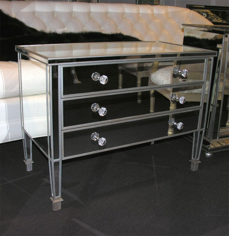 Pair of custom silver trim commodes.