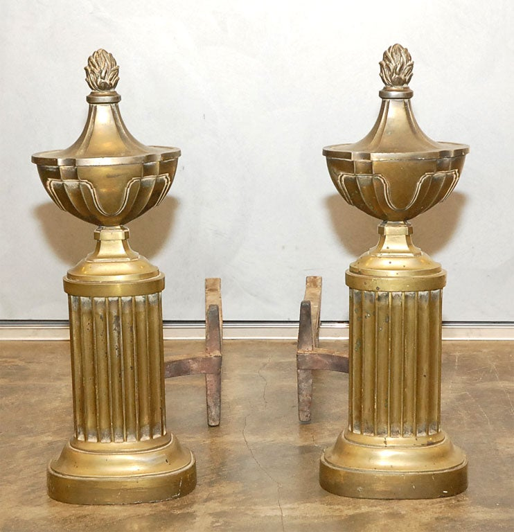 These capped urns with their flaming finials present a pleasing and sophisticated look. Perfect for that antique setting you have in mind.
