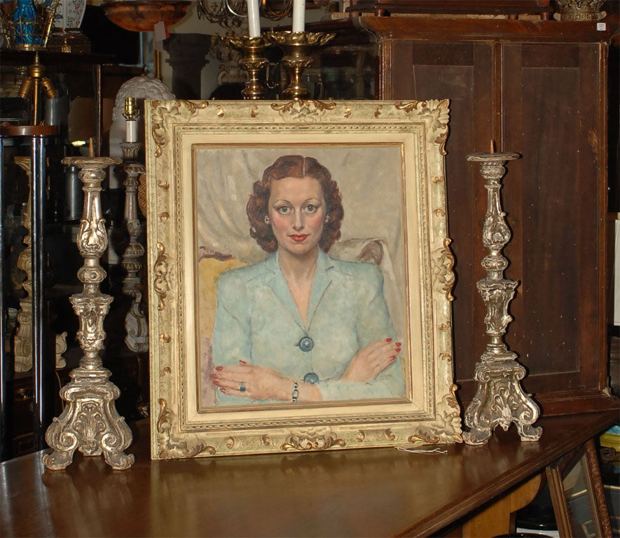 Mid 20th century oil on canvas portrait of a woman, unsigned. The dimensions below include the frame. The image itself is 24