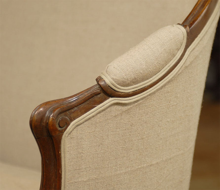 Carved French Louis XV Style Walnut Upholstered Canapé with Wraparound Back, circa 1850 For Sale