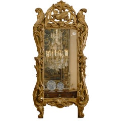 Louis XV Period Giltwood Mirror with Wine Trophy Crest, France, circa 1760