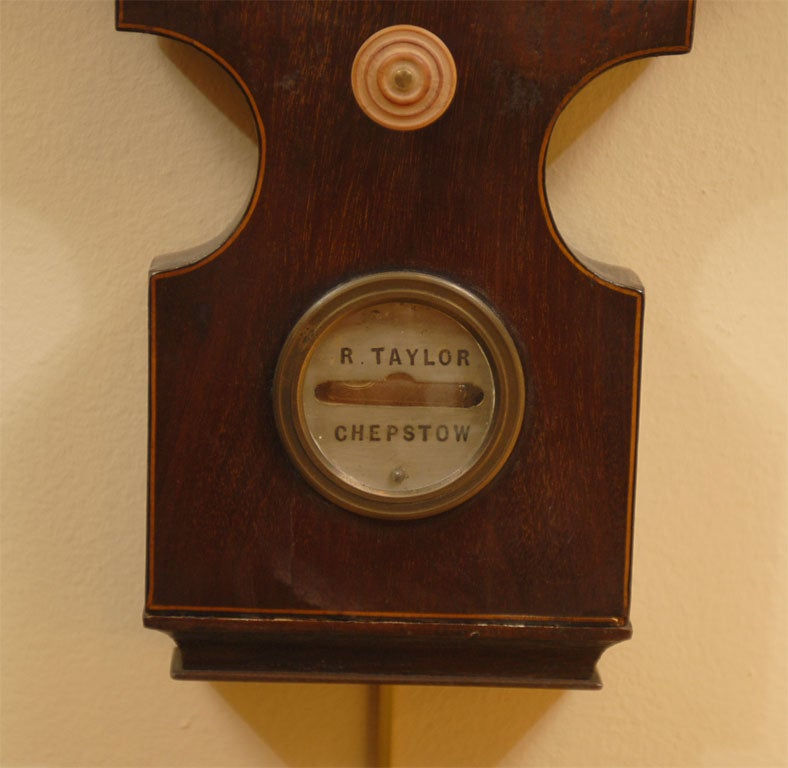 A Four-dial Barometer/Thermometer in Mahogany, dating from the George III period, and English in origin. Signed at the base