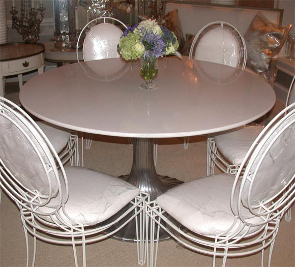 round aluminum base dining table with white granite top at 1stdibs