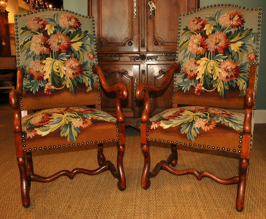 "Pair of Louis XIV style ""Os de Mouton"" armchairs.  More recent tapestry fabric on front, velvet on back, edged with large brass nailheads."