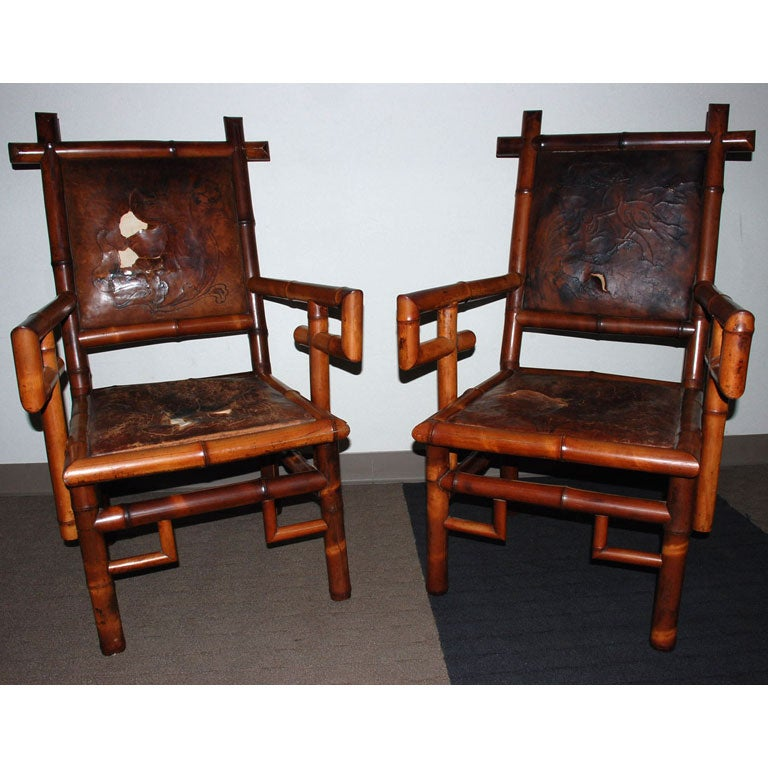 Pair of signed unusual bamboo armchairs with leather back and seats. Original leather and surface.