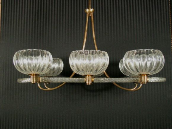 #1-871 Large  twisted Murano glass /brass ceiling fixture. The horizontal frame supports six large hand blownglass bobaches. Newly rewired.
