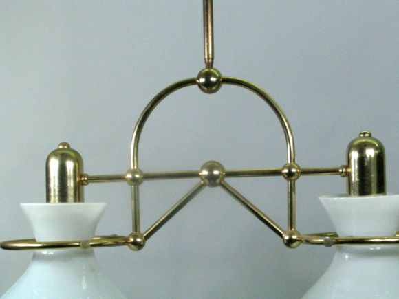 #1-1017, two shaped milk glass shades suspended in brass framework. Brunelli can adjust center pole length.