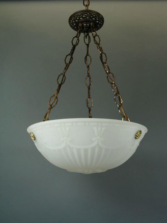 Opaline glass dome with rib, urn and swag detailing. Three lights. Height is adjustable.