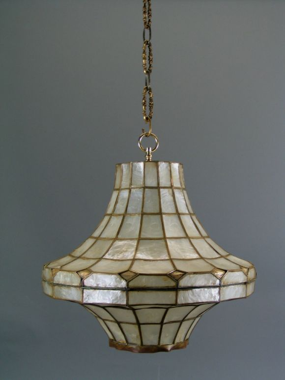 #1-1365ab, capiz shell pagoda shaped lantern with brass frame.  Two available. Priced individually , Takes 3 60 watt bulbs