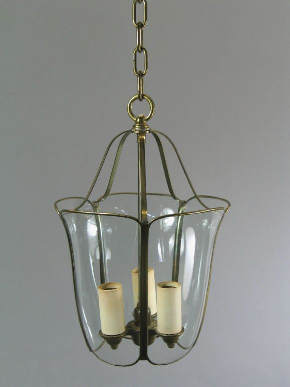 1-1602Bent and curved glass set in brass frame.