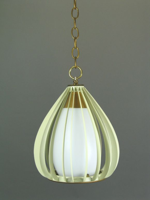 #1-1678ab frosted glass shade set in a metal cage. Priced individually.