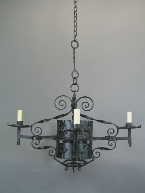 #1-1734, a 1920s four-light scroll work wrought iron chandelier.