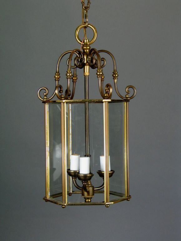 #1-1429, a cast glass six panels lantern. Three internal light. NO ADDITIONAL DISCOUNTS ON SALE ITEMS