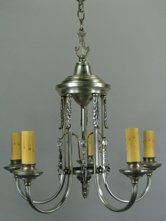 #1-2063, five-light silver plate chandelier with center draped crystals.