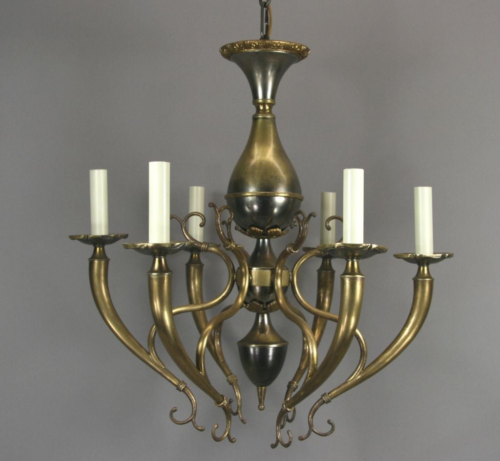 #1-2217,  Italian scrolled six  arm  chandelier in a nickel and brass finish