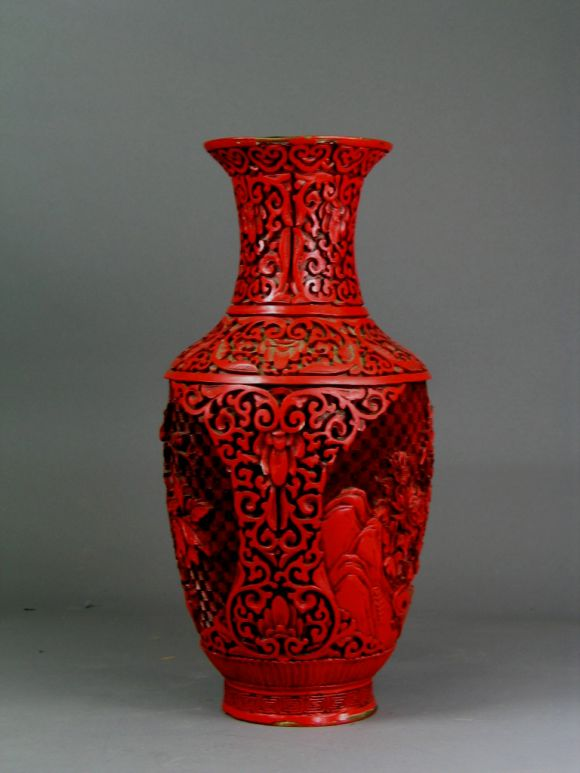 9-027 red carved lacquer over brass.