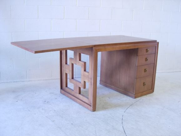 Mahogany desk with four drawers and flip up extension.