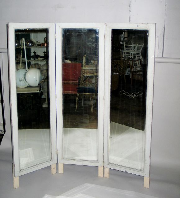 A Floor Standing Three Panel Dressing Mirror Screen Is Old And Has