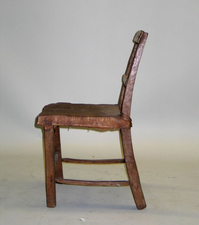 A Primitive Desk / Side Chair with a Seat of Stretched Deerskin.