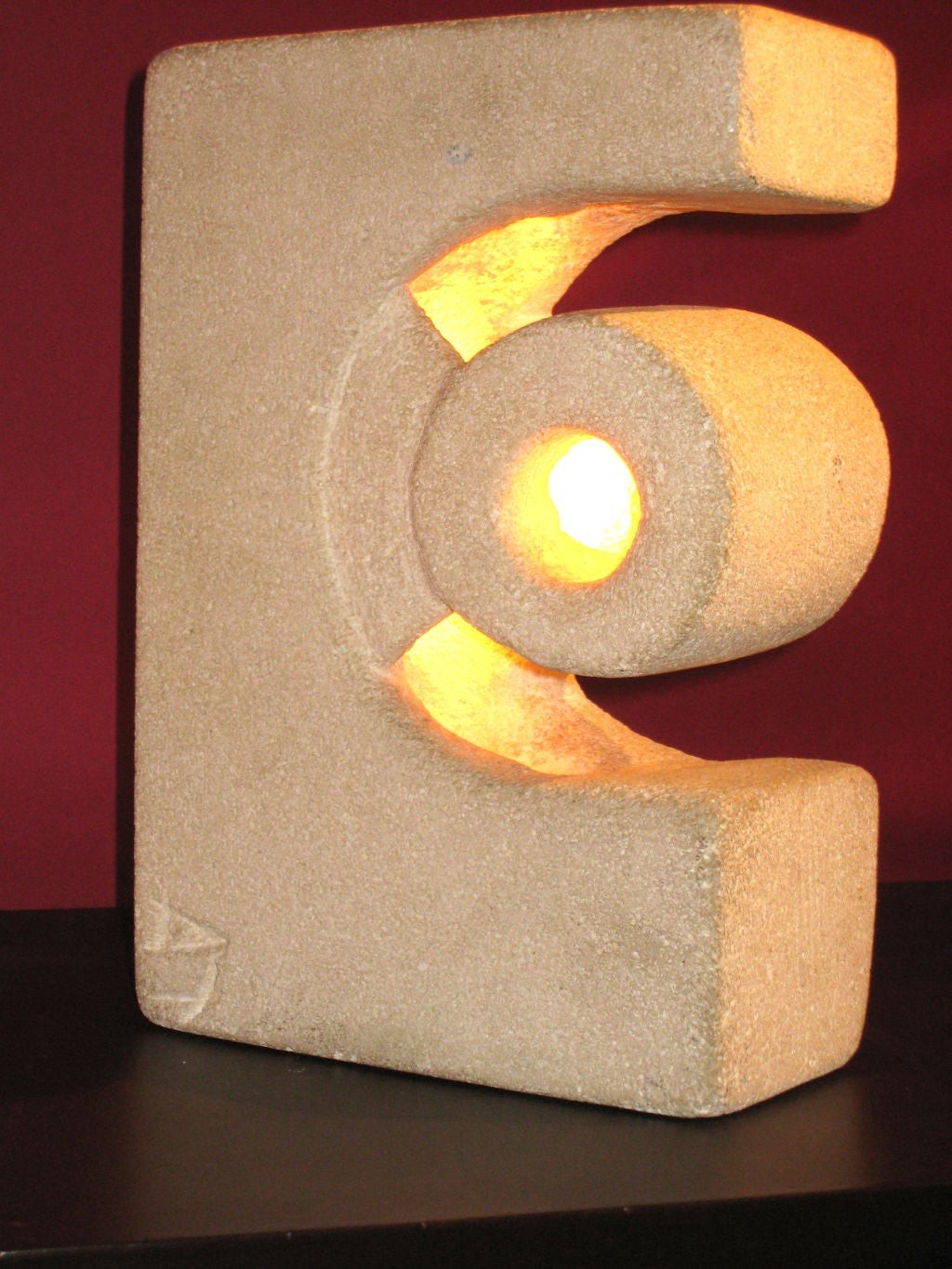 A rare French Modernist lighted sculpture / table lamp in carved limestone by Editions Atelier A.  Initialed on lower left.