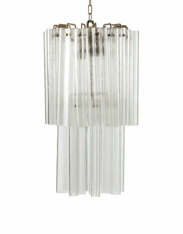 An elegant pair of Italian Mid-Century Modern Classic Veniniwall lights consisting of handblown opaque and colorless venetian glass formed in an organic pattern with each glass piece intersecting each other.