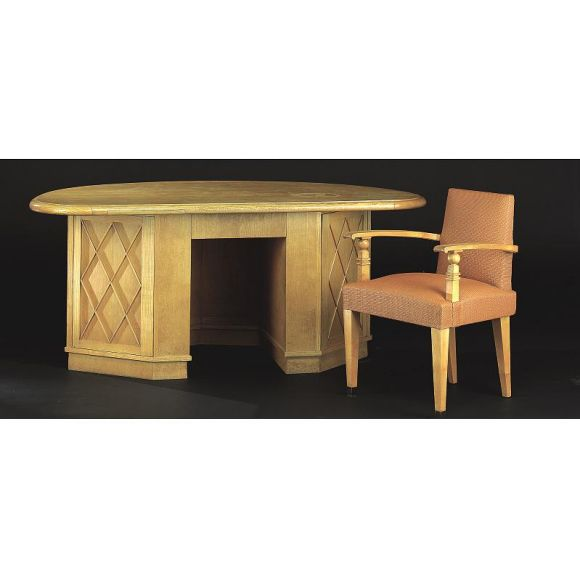 Large elegant French Mid-Century Modern neoclassical oval form oak desk attributed to French architect and landscape designer, Jean-Charles Moreux. The side panels are formed by doors decorated with cross-banded