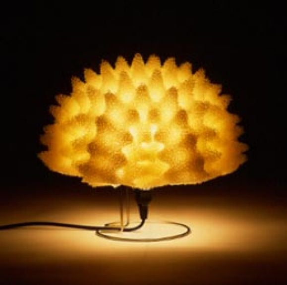 Alight sculpture / desk / table lamp made from sponge creating a warm lighting presence and brilliant sculptural form by Japanese Artist, Masayo Ave, designed in 1998 for Antonangeli Illuminazione. Ave's work is informed by sensory experience and