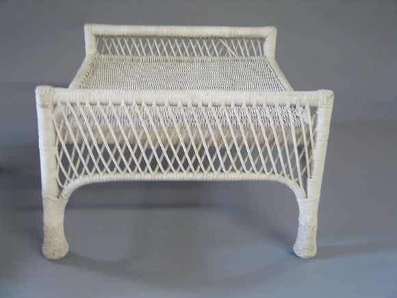 Pair of French Mid-Century Classic wicker stools or ottomans with an elegant cross-hatched frame.    Shown without cushions