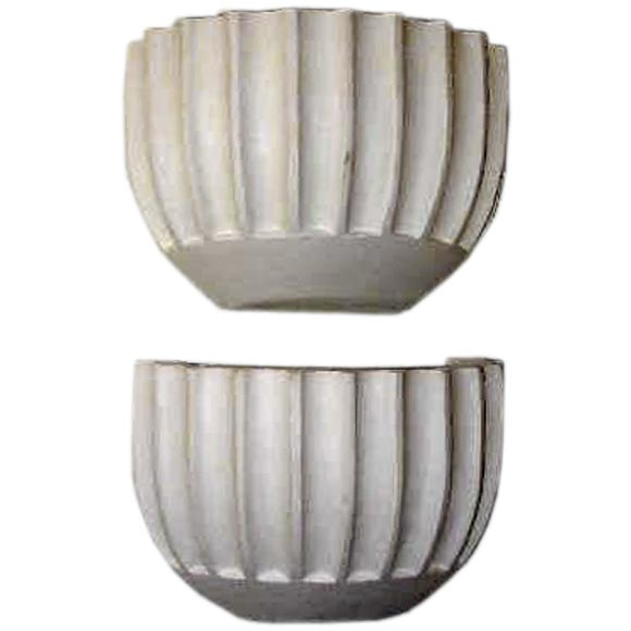 Two Elegant Pairs of French Mid-Modern / Late Art Deco Style plaster wall lights with a sober, modern neoclassical spirit with a channeled design. One socket each.  Priced and sold by the pair.