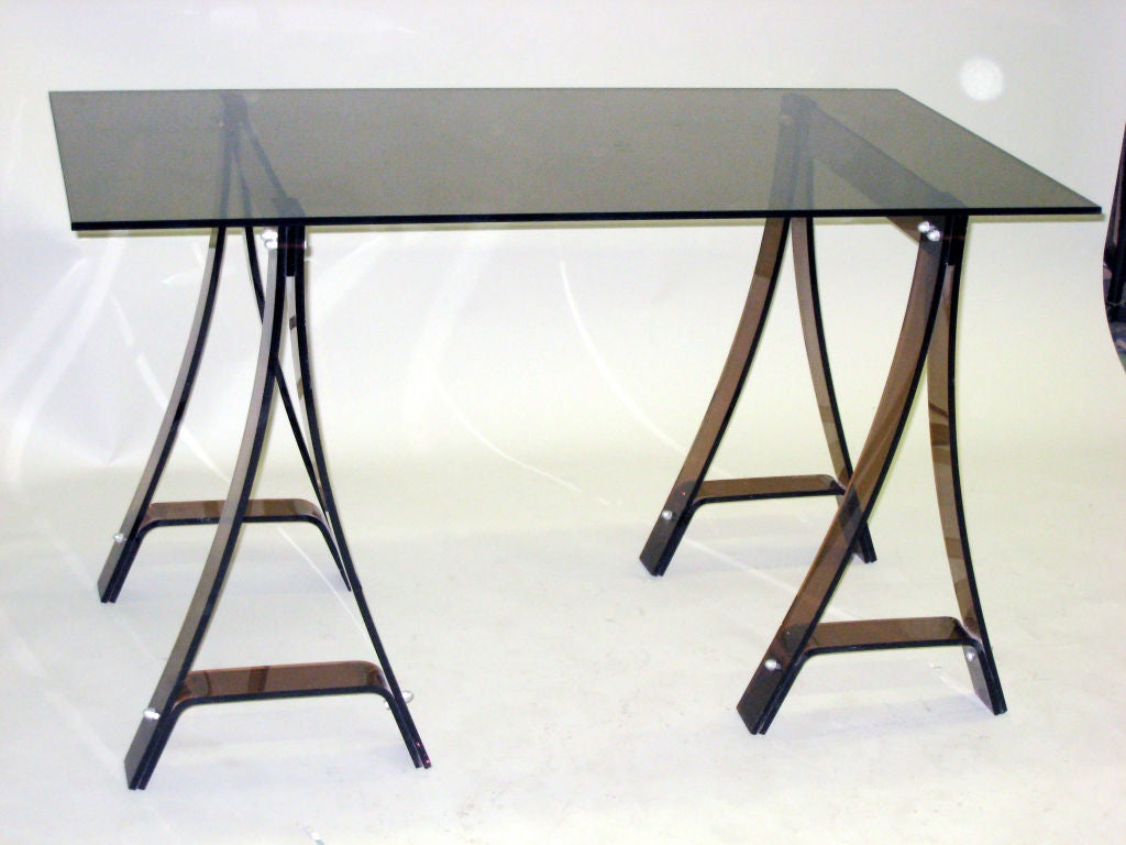Elegant Italian Mid-Century writing table or desk with base of colored plexiglass and a top of glass.
