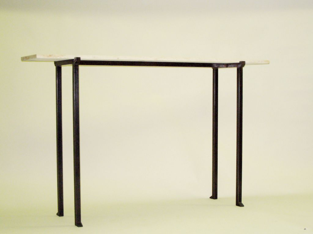 2 Elegant French Mid-century style consoles or sofa tables in the Modern Neoclassical spirit with bronzed wrought iron bases and jura limestone tops. The tops of the bronzed iron frames are delicately notched for the stone to fit securely and the