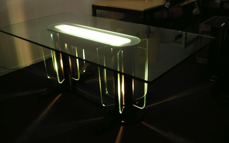 Illuminated 1930s  table. The top center  of the base is frosted glass with silvered border. Lacquered wood frame table with glass fins and glass top. The base illuminates from within, lighting up the center of the top as well as the glass fins.