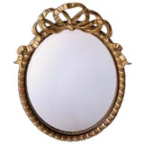 Large-Scaled Napoleon III Ebonized and Giltwood Oval Mirror