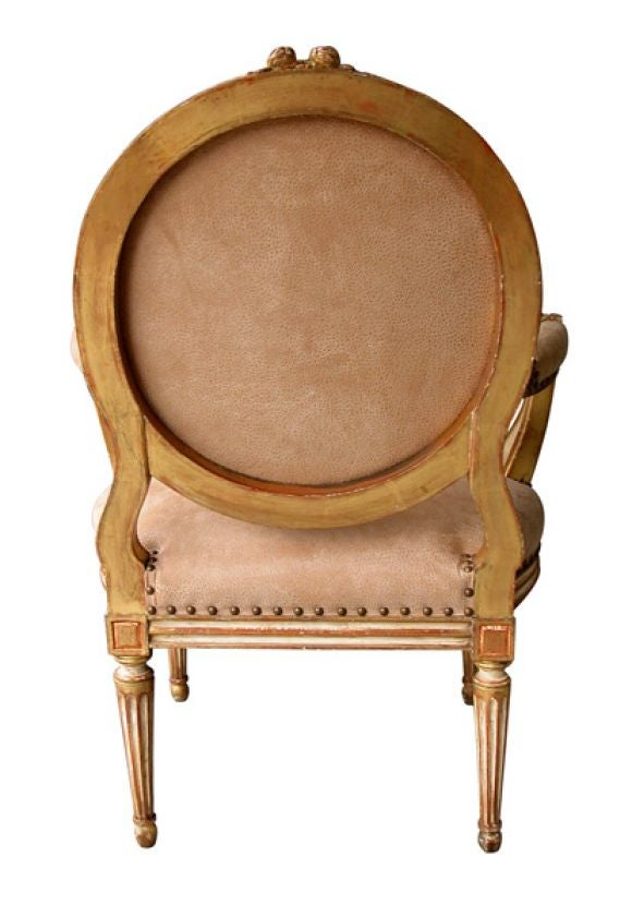 A Large-Scaled French Louis XVI Style Ivory Painted and Parcel Gilt Oval Back Open Armchair 4